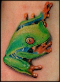 Cute little green frog tattoo