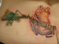 Frog and spider on a tree branch tattoo