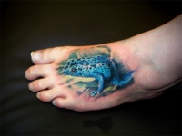 Realistic blue poisonous frog tattoo on foot