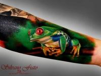 Wonderful realistic frog forearm tattoo